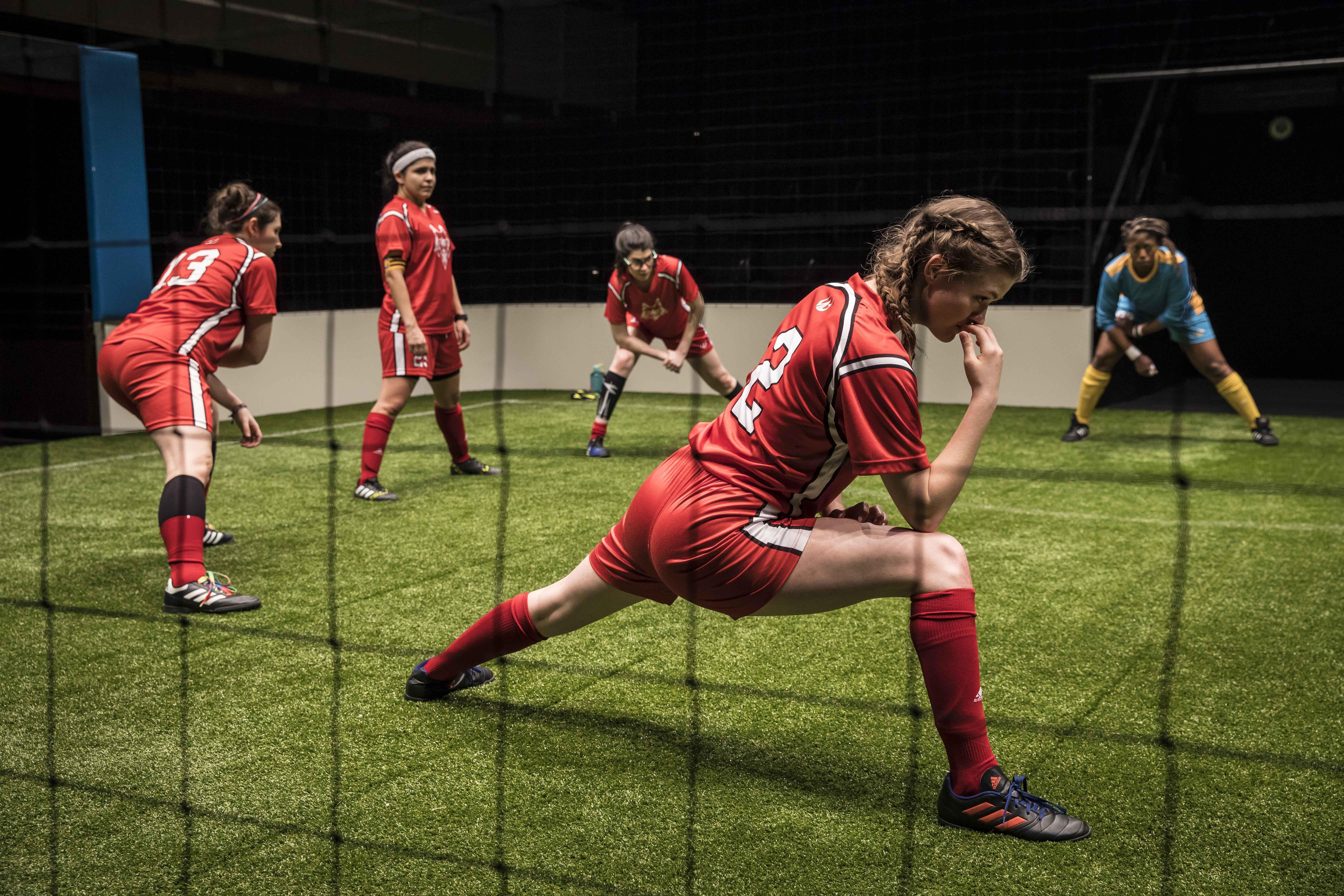 "Taylor Blim (No. 2), Mary Tilden (No. 13), Isa Arciniegas (No. 25), Sarah Price (No. 11) and Angela Alise (No. 00) in ""The Wolves"" at Goodman Theatre. (Credit: Liz Lauren)"