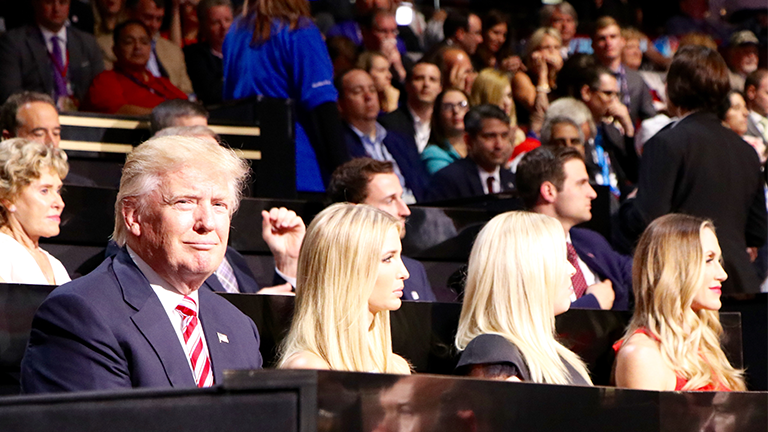 Republican presidential nominee sits with his daughters Ivanka and Tiffany during his son Eric's speech on the third day of the Republican National Convention. (Evan Garcia / Chicago Tonight)