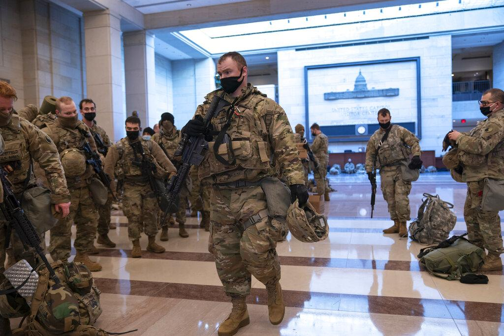 Hundreds of National Guard troops hold inside the Capitol Visitor's Center to reinforce security at the Capitol in Washington, Wednesday, Jan. 13, 2021. (AP Photo / J. Scott Applewhite)