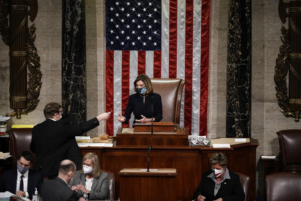 Speaker of the House Nancy Pelosi, D-Calif., leads the final vote of the impeachment of President Donald Trump, for his role in inciting an angry mob to storm the Congress last week, at the Capitol in Washington, Wednesday, Jan. 13, 2021. (AP Photo / J. Scott Applewhite)