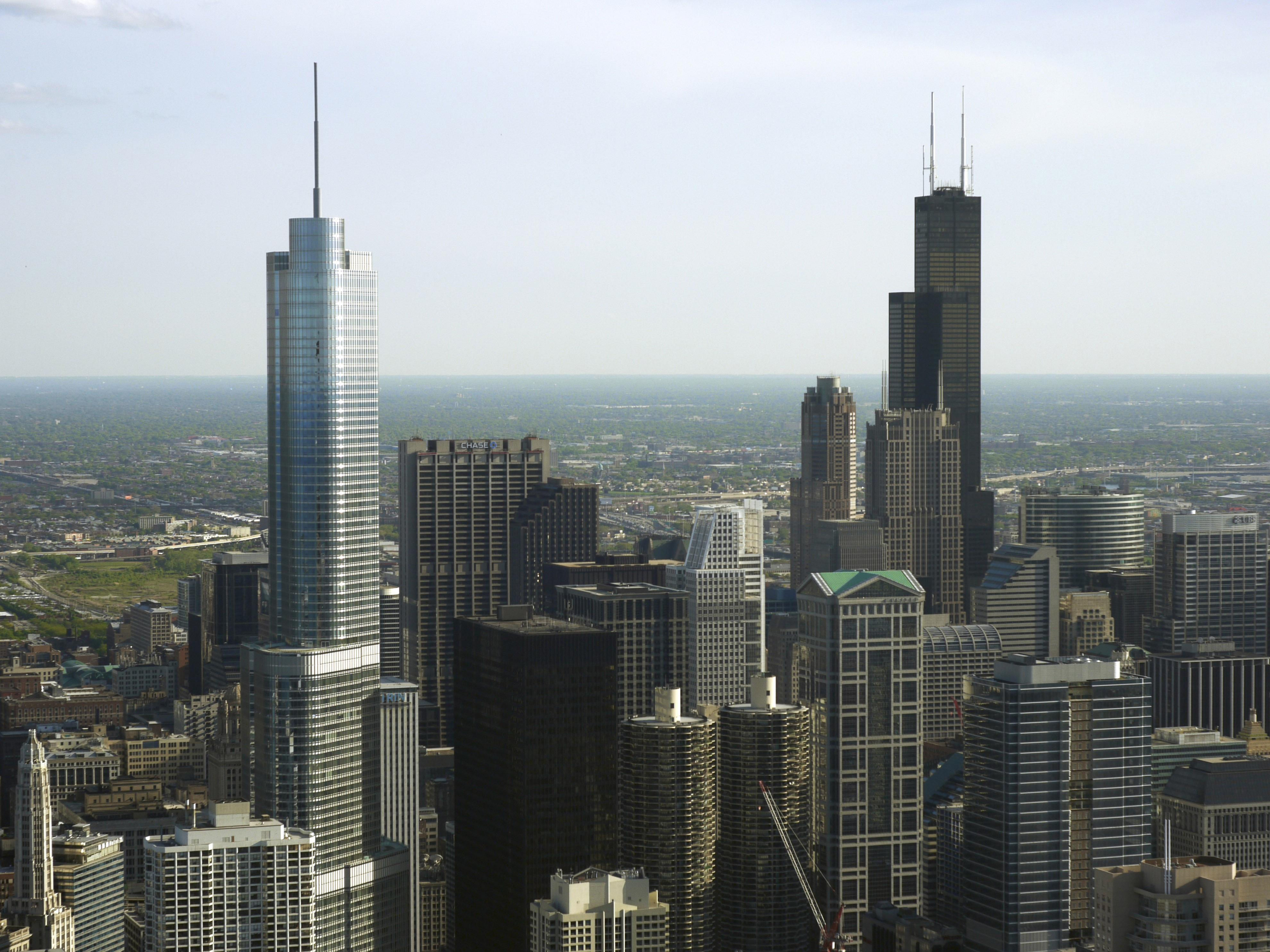 Chicago's Willis Tower, right, scored a 55 on the Environmental Protection Agency's Energy Star rating system. Trump Tower, left, scored a nine. (Chad Kainz / Flickr)