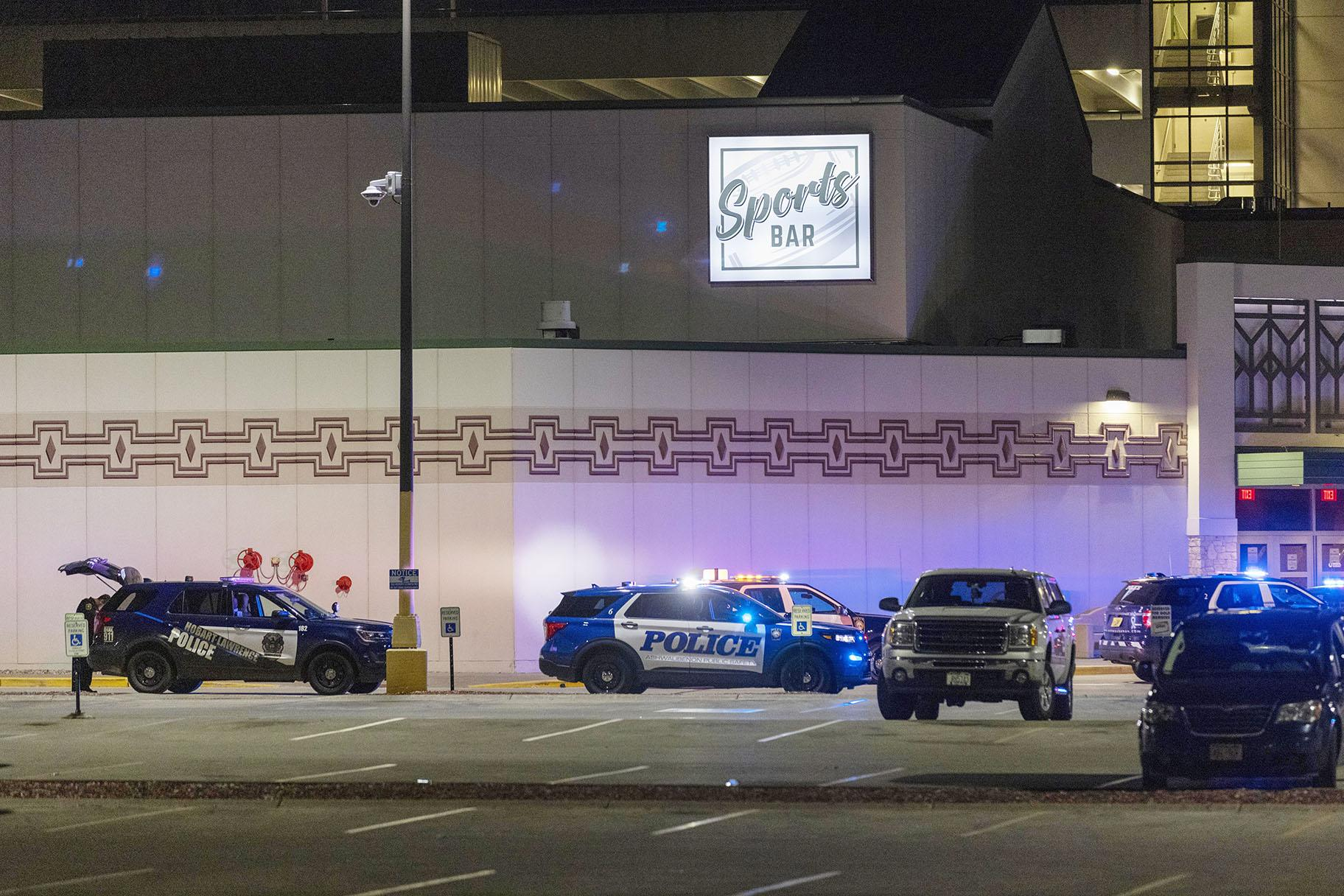 Police line the parking lot outside the Oneida Casino in the early morning hours of Sunday, May 2nd, 2021, near Green Bay, Wisconsin. (AP Photo / Mike Roemer)
