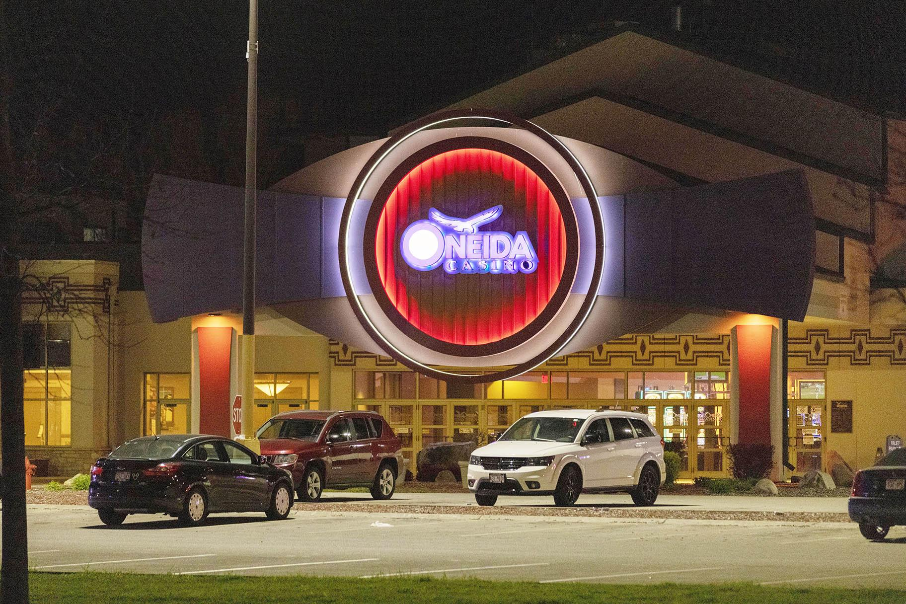 The Oneida Casino lights glow in the parking lot in the early morning hours of Sunday, May 2nd, 2021, near Green Bay, Wisconsin. (AP Photo / Mike Roemer)
