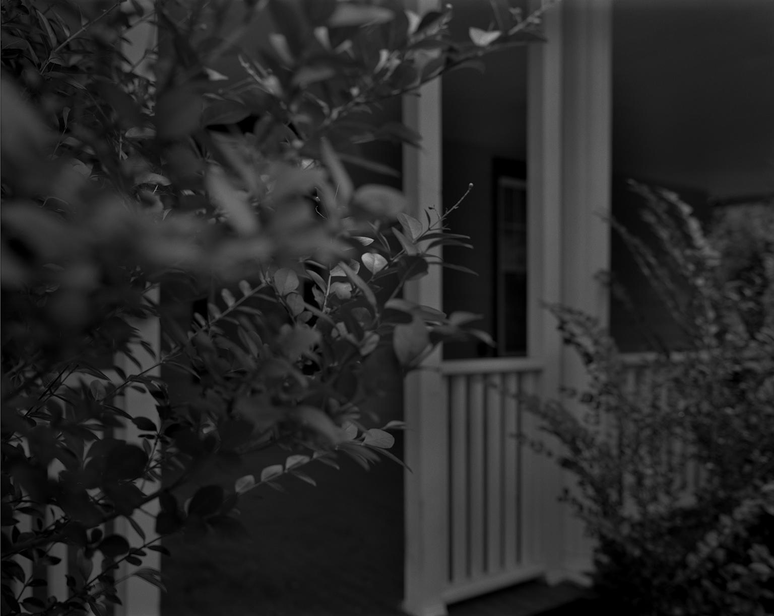 "Dawoud Bey. ""Untitled #4 (Leaves and Porch),"" from the series ""Night Coming Tenderly, Black,"" 2017. Rennie Collection, Vancouver. © Dawoud Bey."