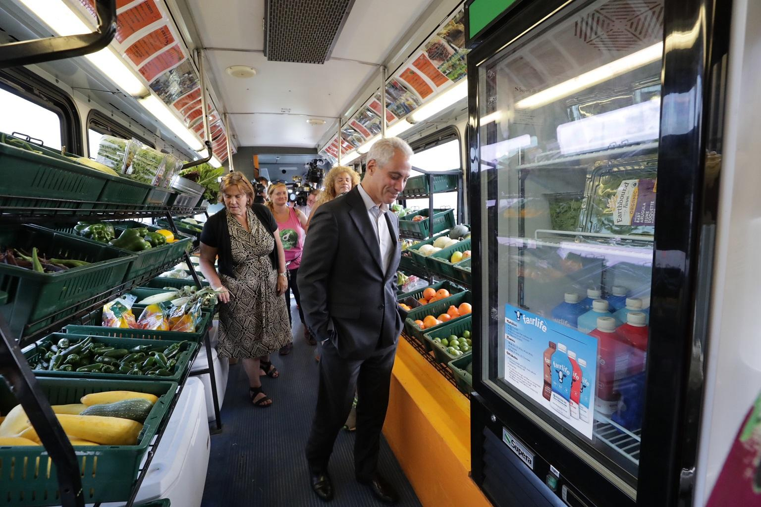 Mayor Rahm Emanuel tours a mobile market operated by the Urban Growers Collective during an event on Aug. 22, 2018. (Courtesy City of Chicago)