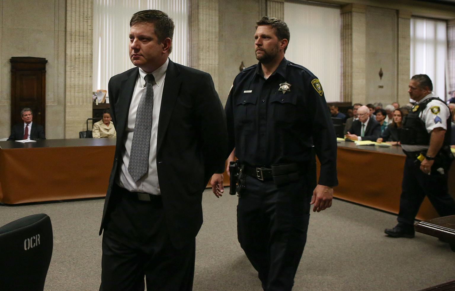 Chicago police Officer Jason Van Dyke is led out of the courtroom following the verdict announcement Friday, Oct. 5, 2018. (Antonio Perez / Chicago Tribune / Pool)