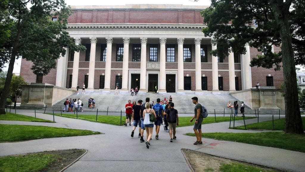 In this Aug. 13, 2019 file photo, students walk near the Widener Library in Harvard Yard at Harvard University in Cambridge, Mass. (AP Photo / Charles Krupa, File)