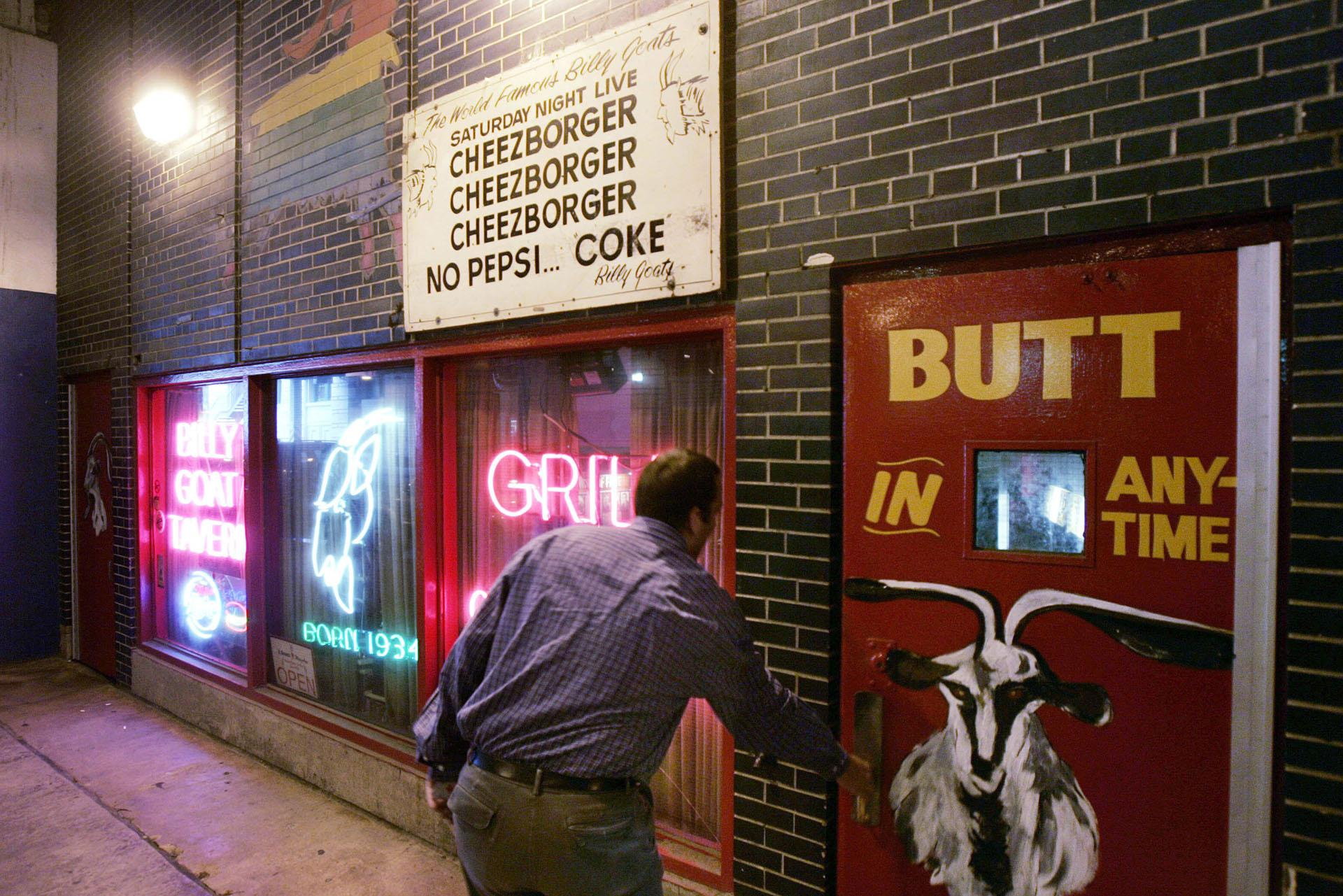 In this Sept. 23, 2005 file photo, a customer enters the Billy Goat Tavern under Chicago's Michigan Avenue. (AP Photo / Charles Rex Arbogast, File)