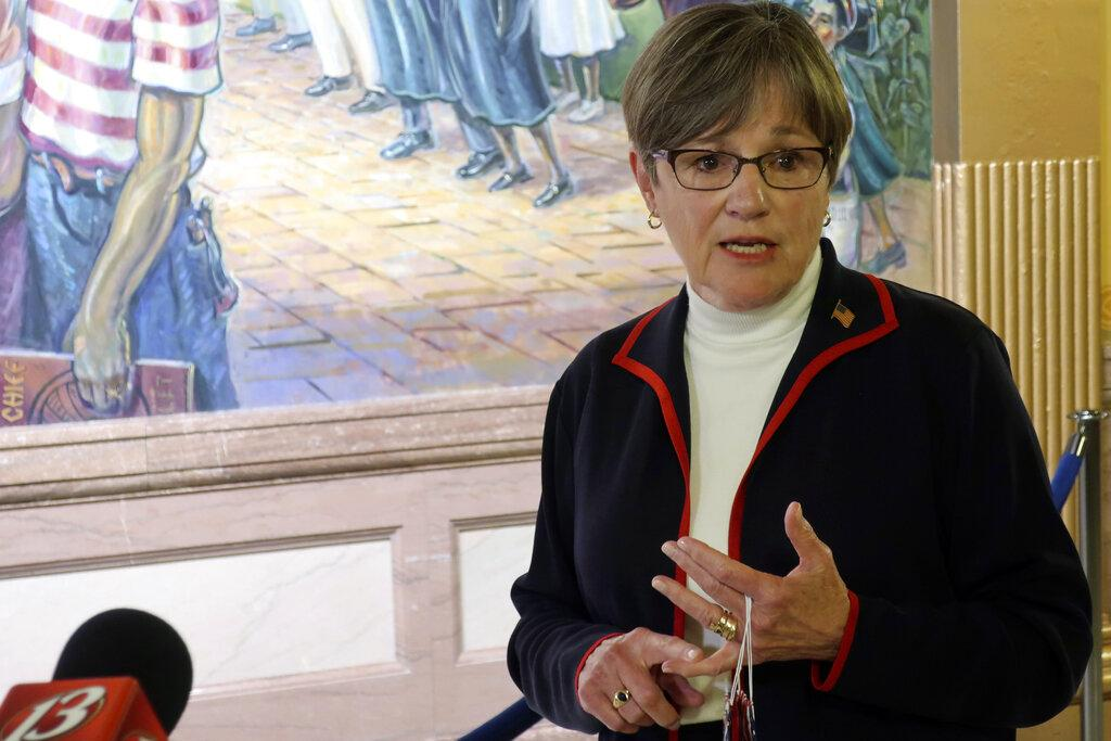 Kansas Gov. Laura Kelly answers questions from reporters about the coronavirus pandemic after a meeting with legislative leaders, Thursday, July 2, 2020, at the Statehouse in Topeka, Kan. (AP Photo / John Hanna)