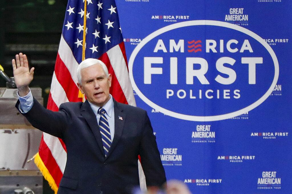 In this June 12, 2020, file photo, Vice President Mike Pence waves as he arrives to speak after a tour at Oberg Industries plant in Sarver, Pa. (AP Photo / Keith Srakocic, File)