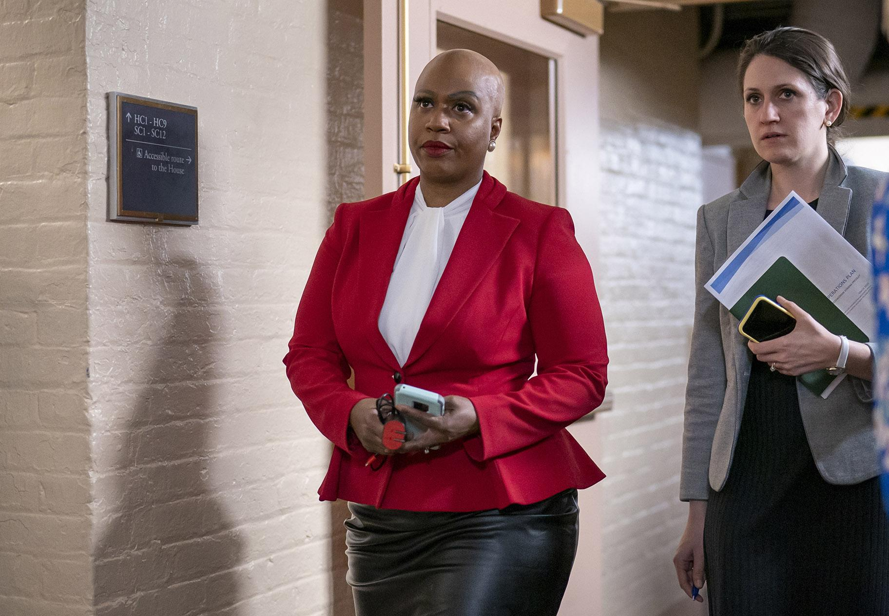 In this Wednesday, March 11, 2020, file photo, Rep. Ayanna Pressley, D-Mass., and other House Democrats arrive to meet with Speaker of the House Nancy Pelosi, D-Calif., on Capitol Hill in Washington. (AP Photo / J. Scott Applewhite, File)