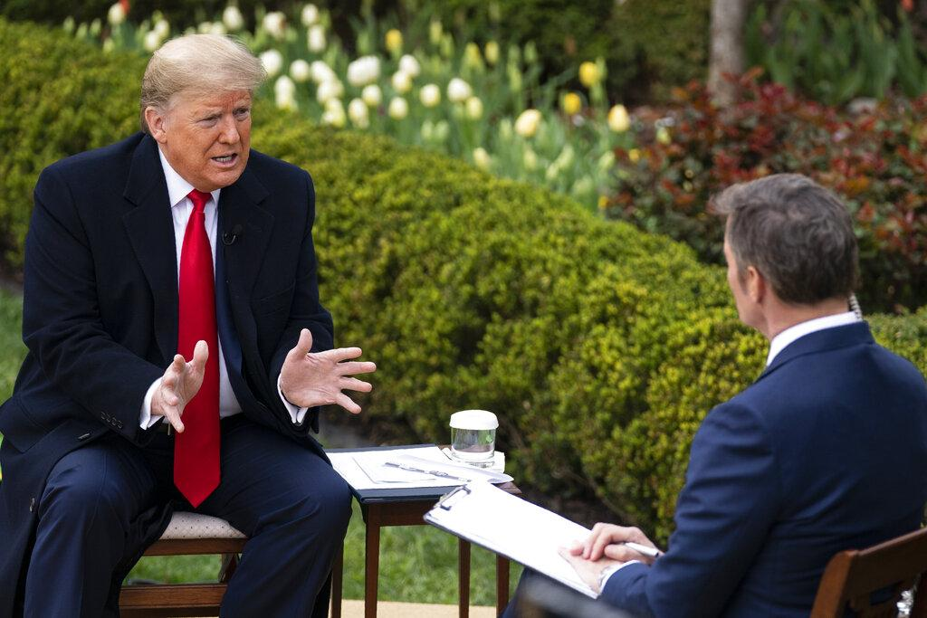 President Donald Trump talks with host Bill Hemmer during a Fox News virtual town hall with members of the coronavirus task force, in the Rose Garden at the White House, Tuesday, March 24, 2020, in Washington. (AP Photo / Evan Vucci)