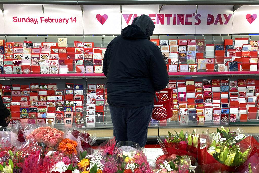 A shopper at a Chicago-area store looks over Valentine's Day cards Saturday, Feb. 13, 2021. (AP Photo / Charles Rex Arbogast)
