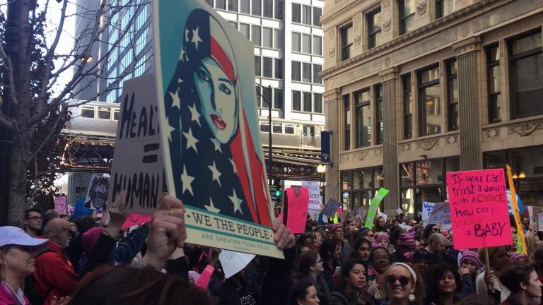 "Chants of ""this is what democracy looks like"" echoed through downtown streets Jan. 21 as an estimated 250,000 individuals joined the Women's March on Chicago. (Maya Miller / Chicago Tonight)"