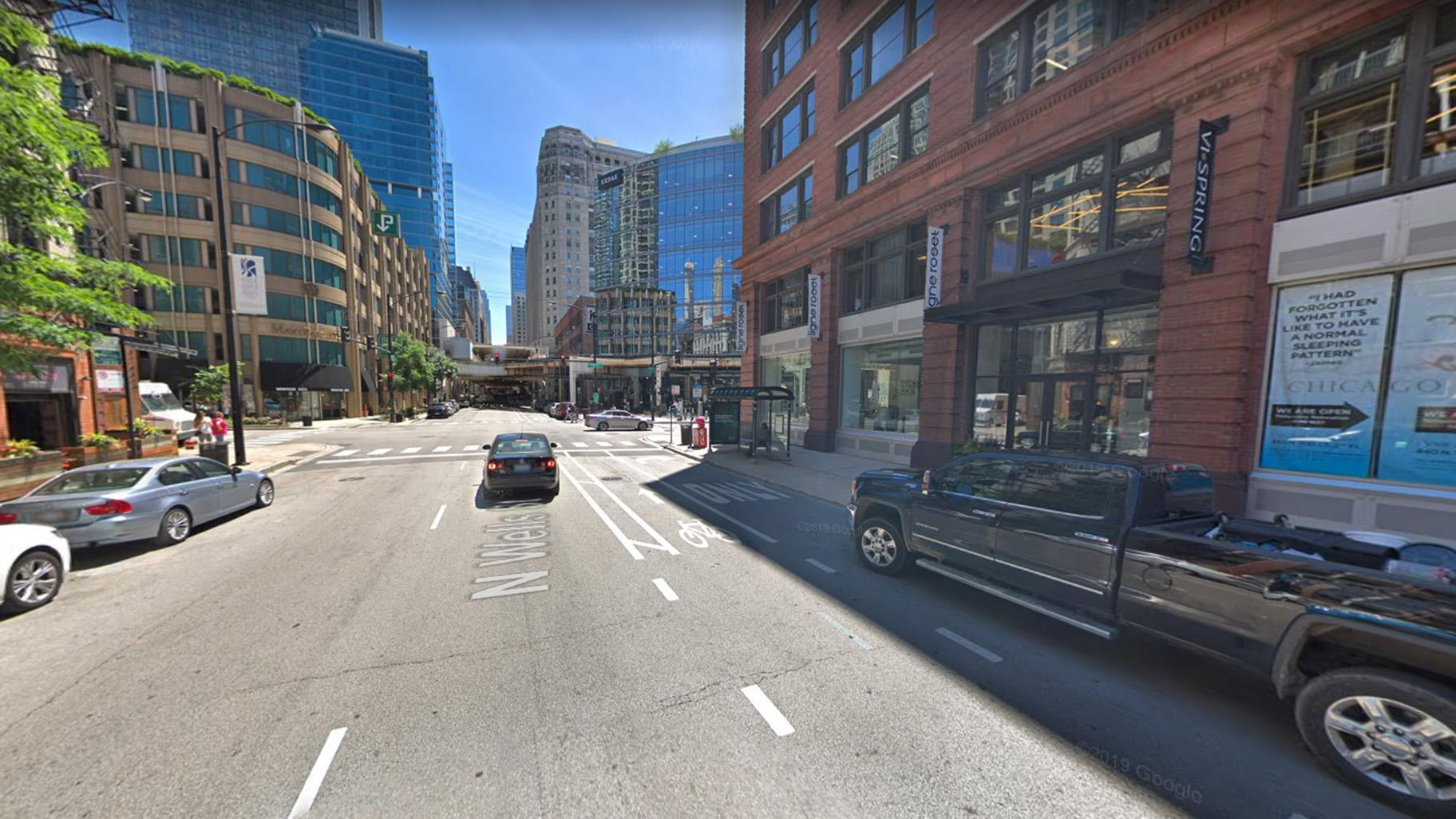 A view of Wells Street looking south to the intersection of Hubbard Street in River North, where  police say a cyclist and CTA bus collided on June 6, 2019. (Google Maps)