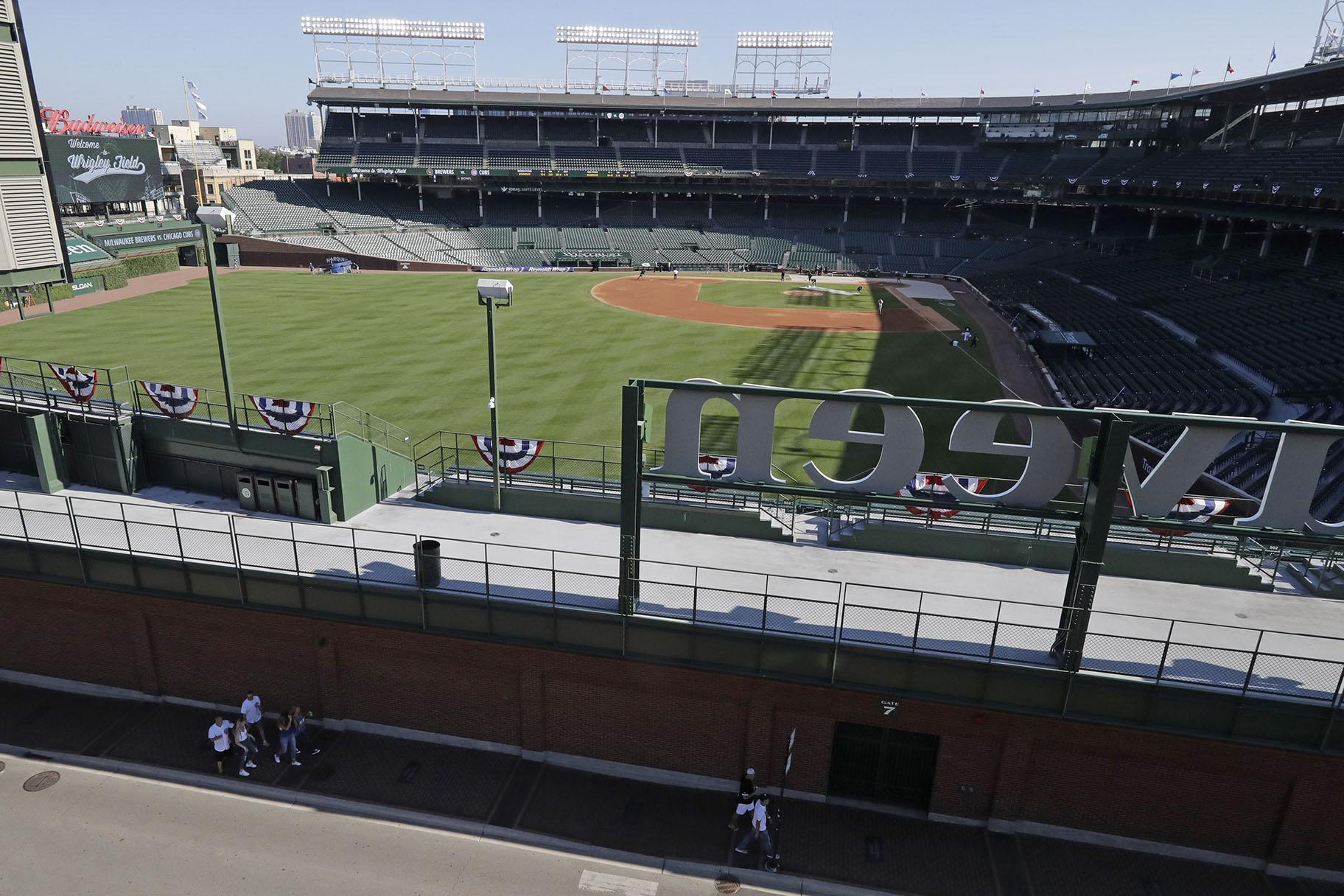 Wrigley Field is viewed from a nearby rooftop before an opening day baseball game between the Chicago Cubs and the Milwaukee Brewers in Chicago, Friday, July 24, 2020, in Chicago. (AP Photo / Nam Y. Huh)