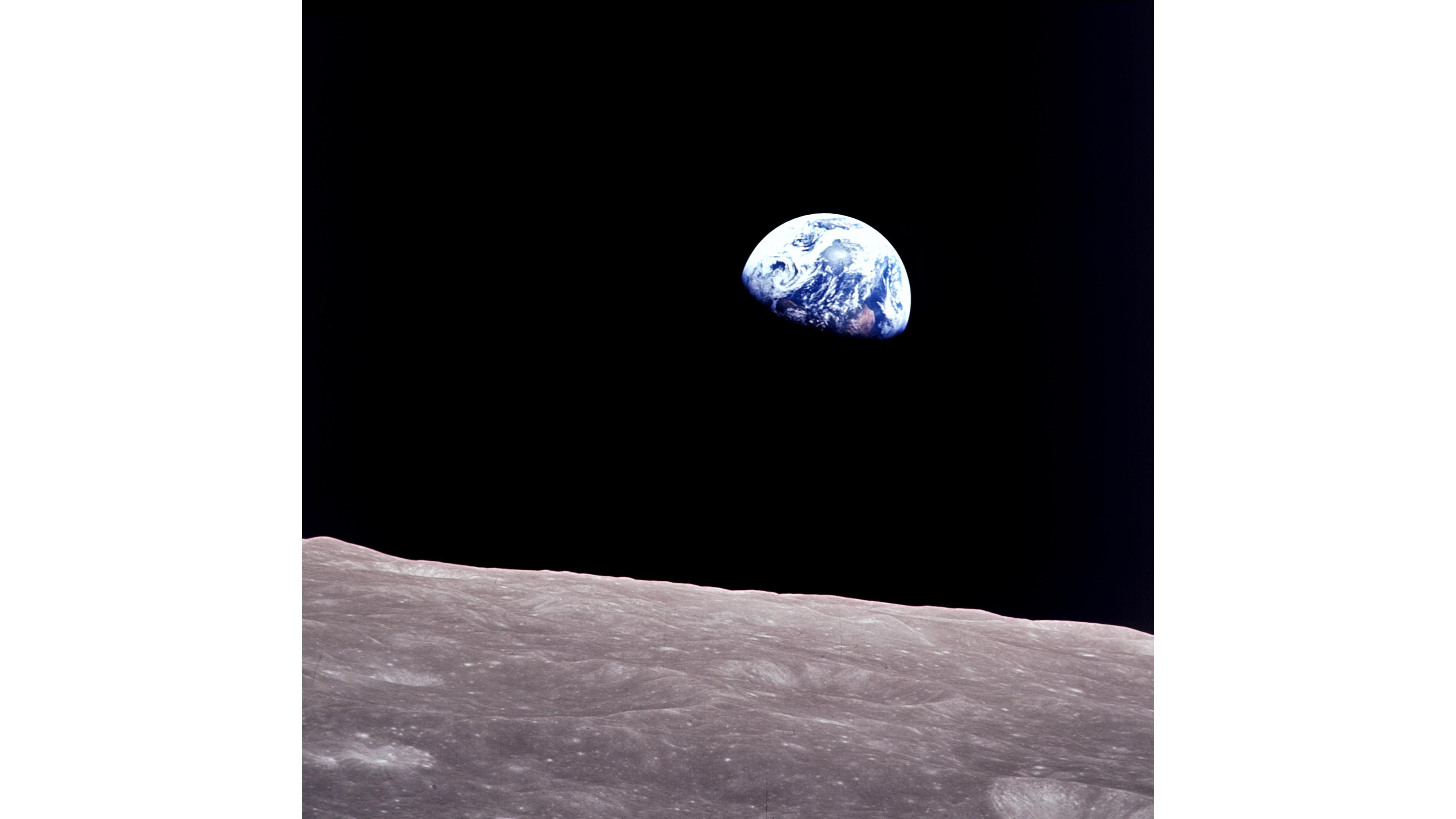 Taken aboard Apollo 8 by Bill Anders, this iconic picture shows Earth peeking out from beyond the lunar surface as the first crewed spacecraft circumnavigated the Moon.
