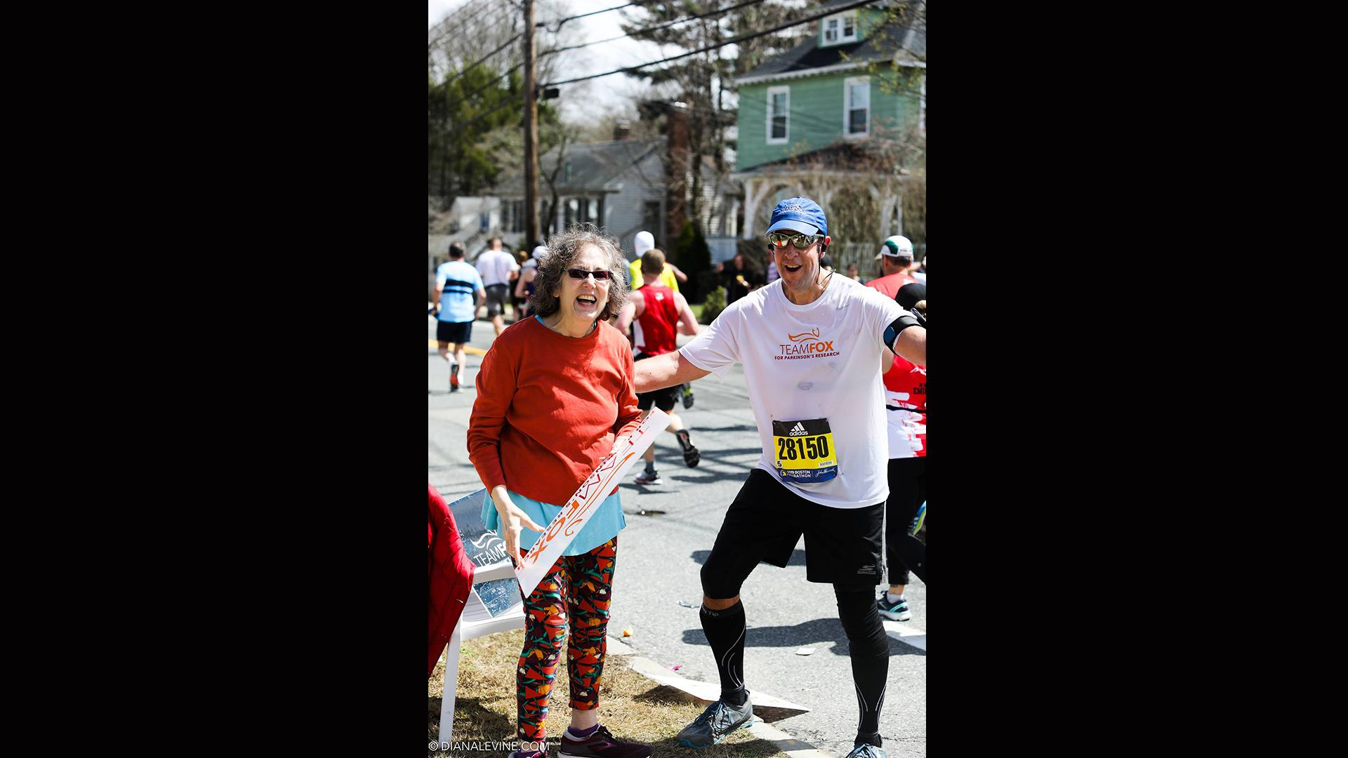 Bill Bucklew, right, poses for a picture with a supporter during the Boston Marathon on April 15, 2019. (Courtesy of Bill Bucklew)