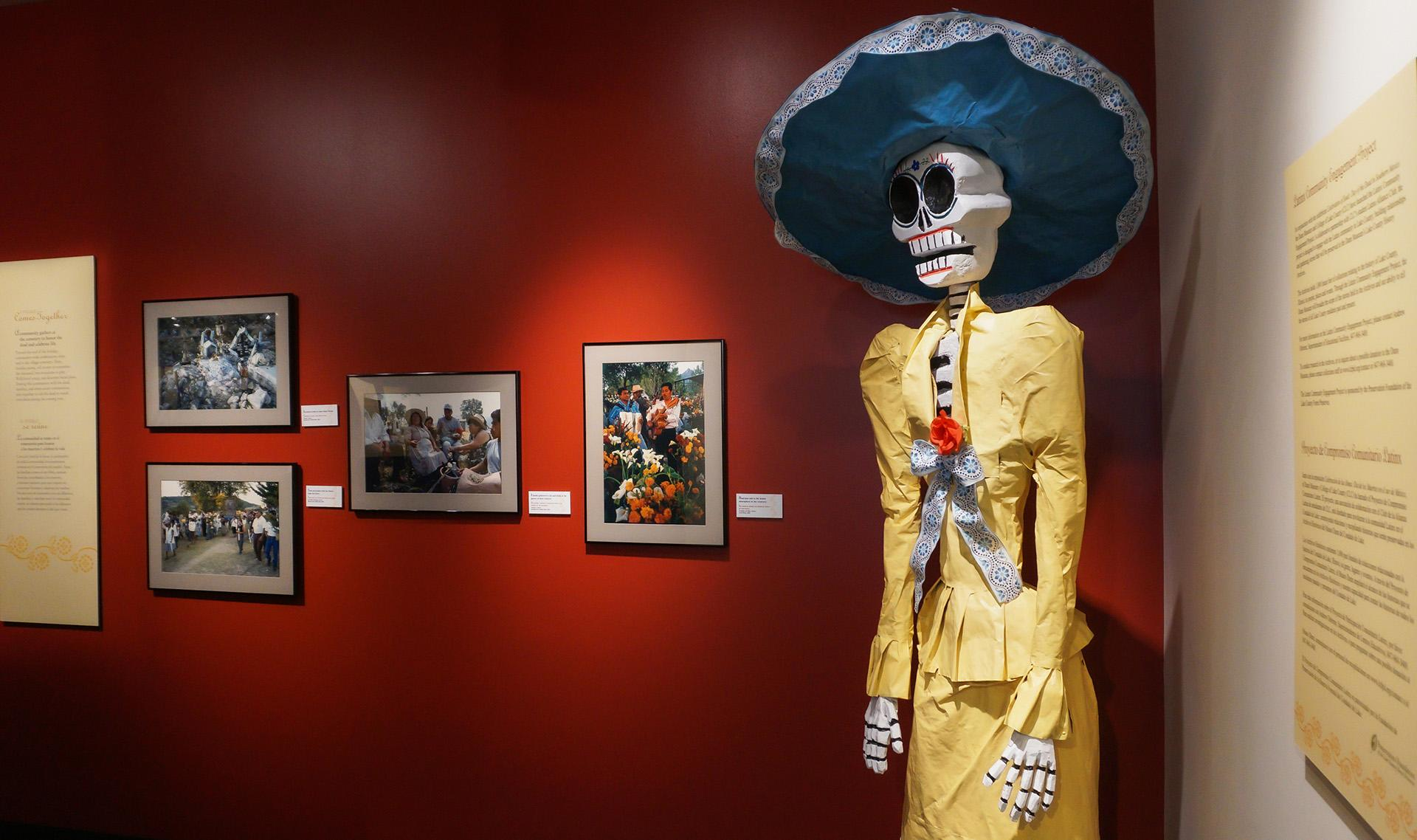 A strong and recognizable symbol of the Day of the Dead celebration is La Catrina, a tall female skeleton wearing bright clothing. Life-size catrinas are included in the exhibit.  (Courtesy of Lake County Forest Preserves)