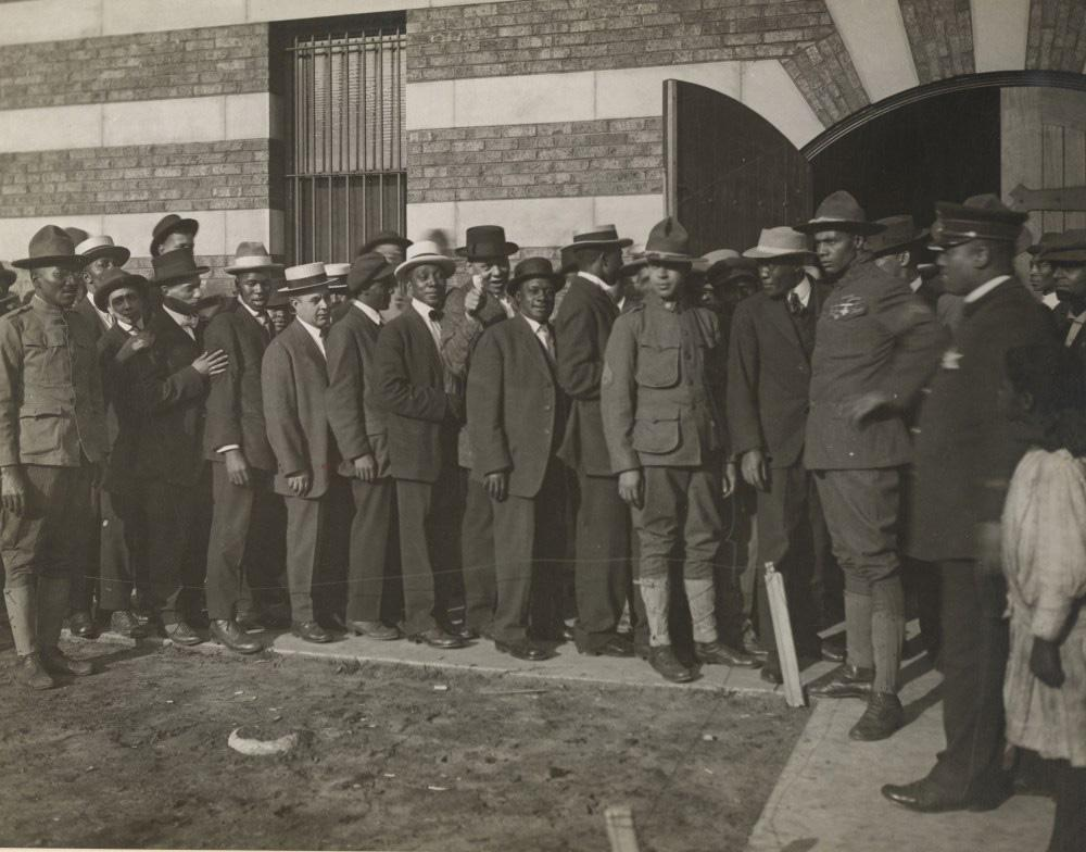 Men line up to enlist in World War I. Though many thought African-Americans only held service jobs during the war, they also comprised a handful of infantry units. (Courtesy of Christopher Reed)