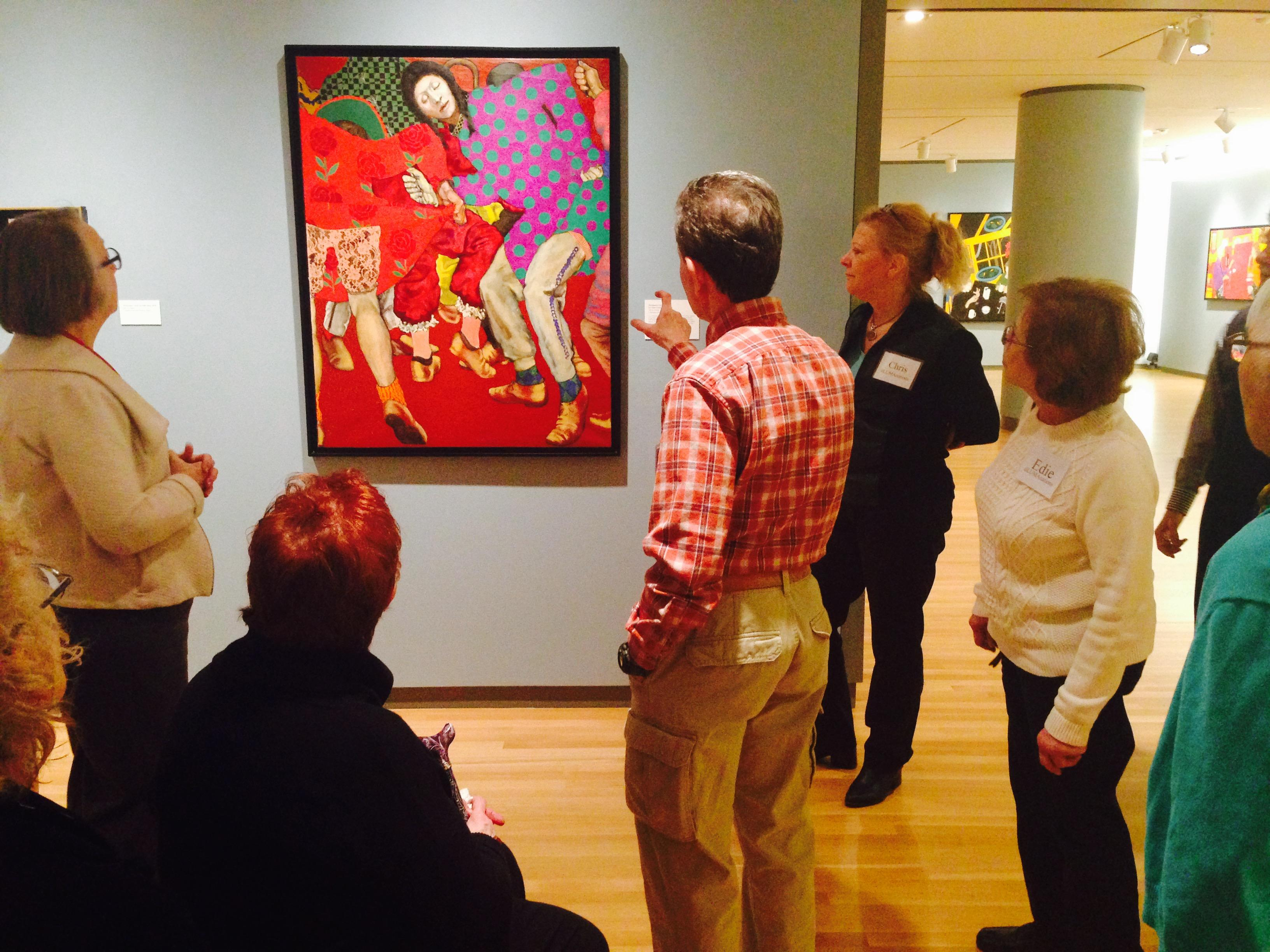 A group of Alzheimer's patients and their caregivers tour the Loyola University Museum of Art exhibit.