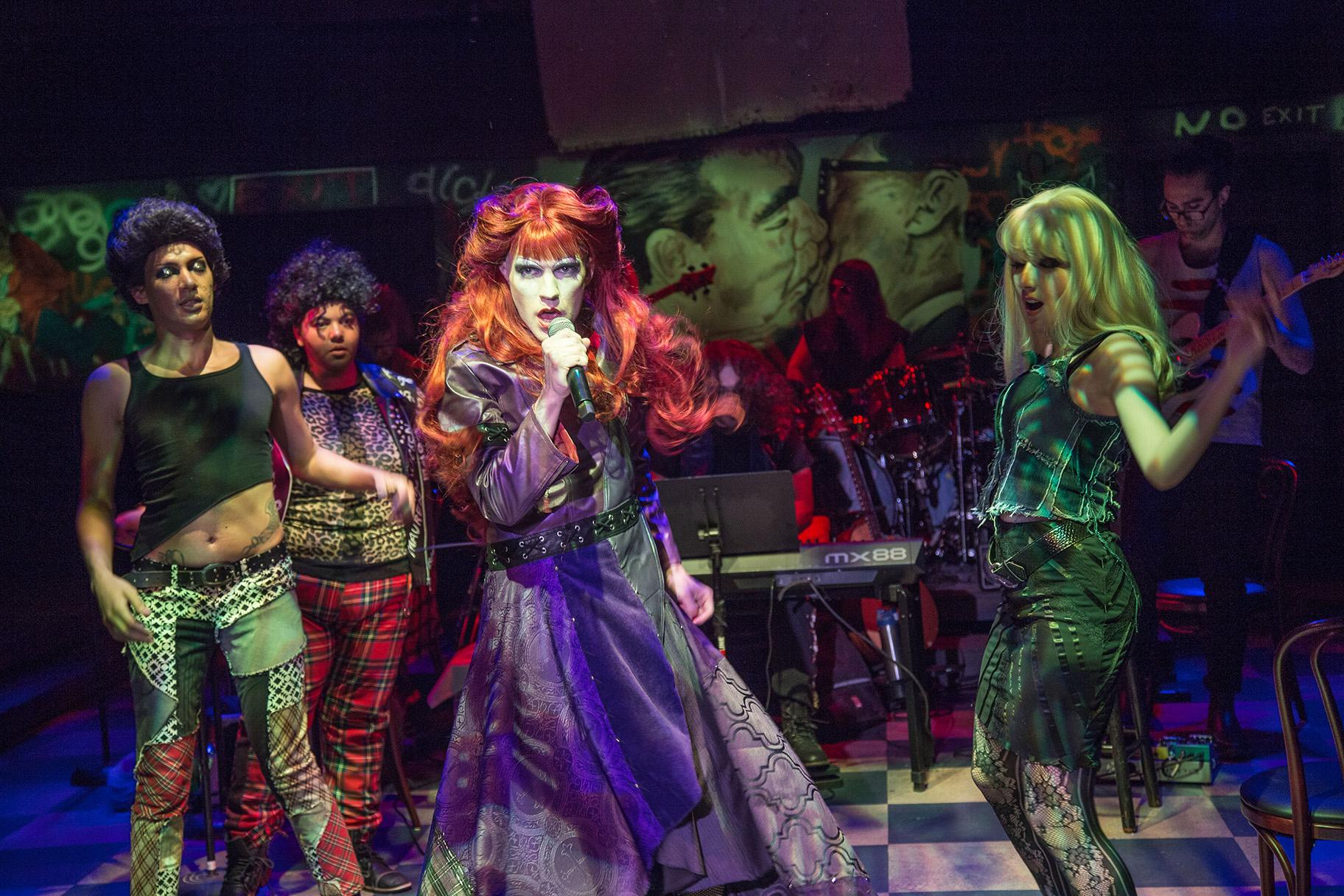 "From left, front: Jacob Gilchrist, Brittney Brown, Will Lidke and Adriana Tronco in ""Hedwig and the Angry Inch."" Background: The Angry Inch Band. (Photo by Austin D. Oie Photography)"