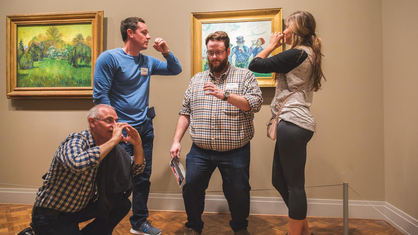 While on a Museum Hack tour at the Art Institute of Chicago, visitors strike a pose in front of the artwork. (Courtesy of Museum Hack)