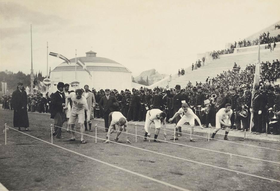 Thomas Burke, second from the left, crouches in his starting position for the 100 meter sprint at the 1896 Olympics. (Courtesy of The Benaki Museum)