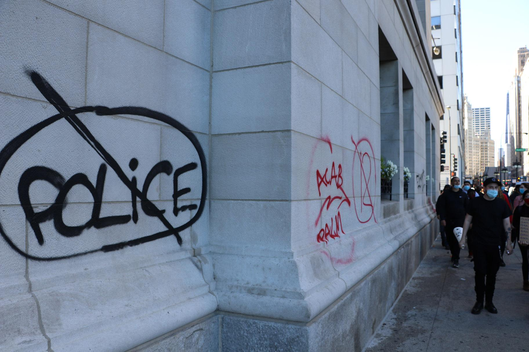 Graffiti was spray-painted throughout the protest route, which covered large parts of the Loop. (Evan Garcia / WTTW News)