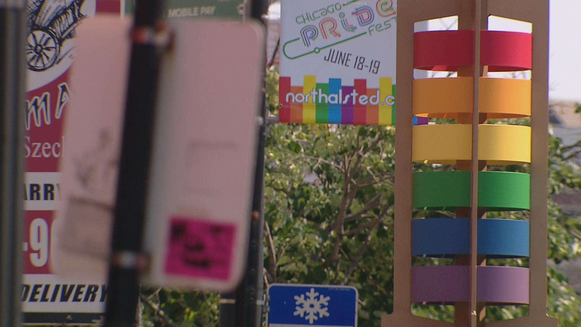 A sign promoting Chicago's annual Pride Fest is seen in Boystown a day after the Orlando mass shooting at a gay club. Mayor Rahm Emanuel said Monday that Chicago's celebration of pride will go on as planned.