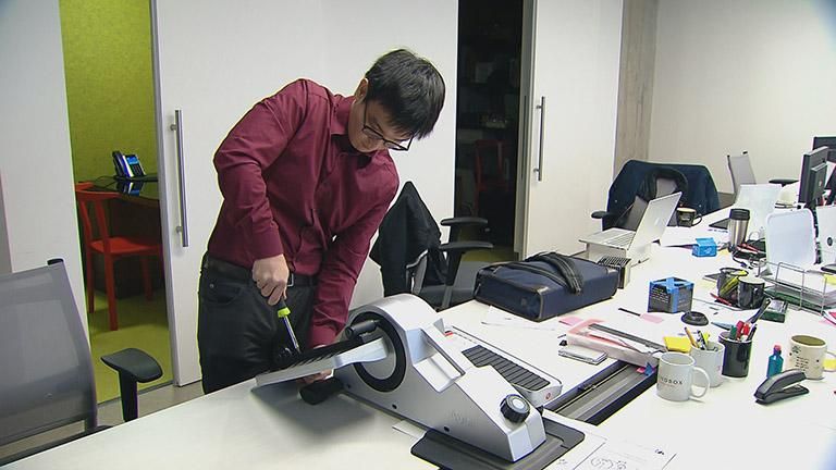 Ryota Sekine, a co-founder of Cubii, works on the small, under-the-desk elliptical machine.