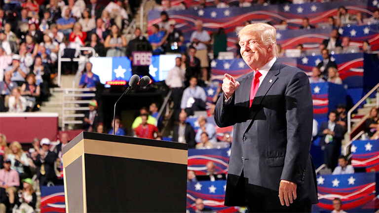 Republican presidential nominee Donald Trump points to the crowd during his speech on the final night of the Republican National Convention in Cleveland. (Evan Garcia / Chicago Tonight)