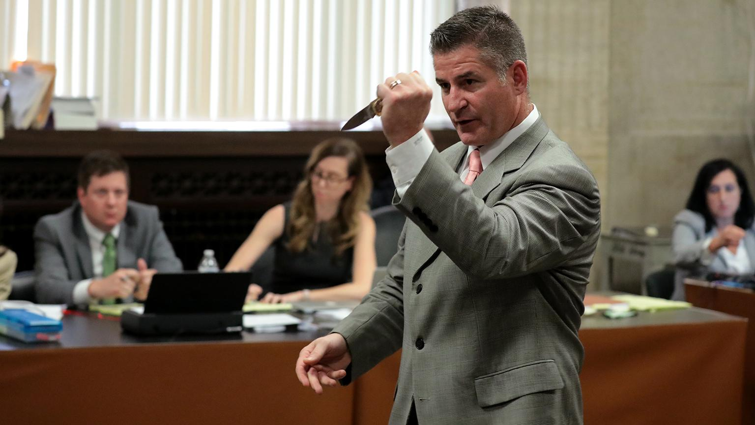 Jason Van Dyke's lead defense attorney Daniel Herbert gestures with Laquan McDonald's knife during the fourth day of the trial on Thursday, Sept. 20, 2018. (Antonio Perez / Chicago Tribune / Pool)
