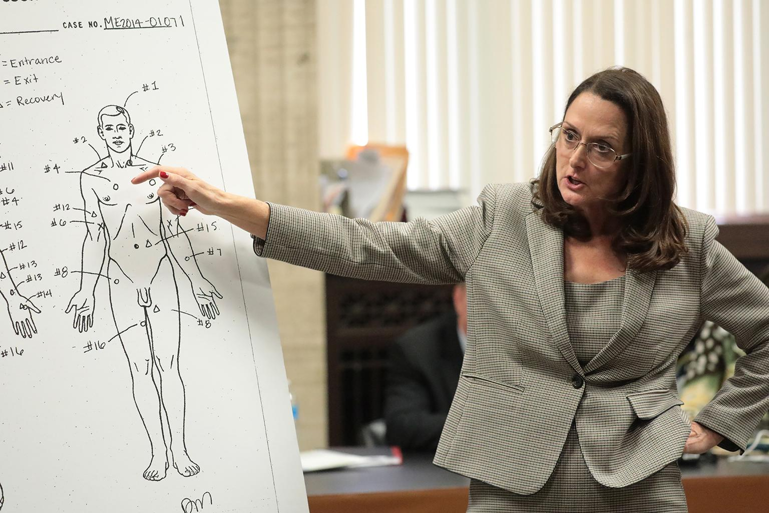 Prosecutor Jody Gleason points to a medical examiner's diagram showing the wounds to Laquan McDonald on Monday, Sept. 24, 2018. (Antonio Perez / Chicago Tribune / Pool)