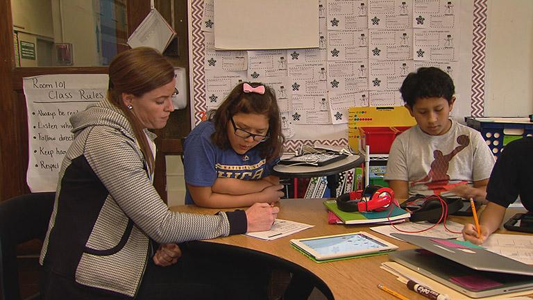 Teacher Whitney Sullivan, left, in her classroom.
