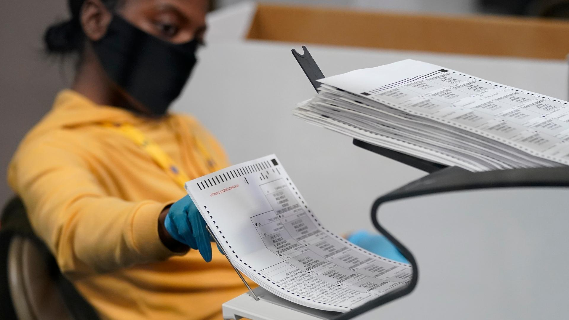 A county election worker scans mail-in ballots at a tabulating area at the Clark County Election Department, Thursday, Nov. 5, 2020, in Las Vegas. (AP Photo / John Locher)
