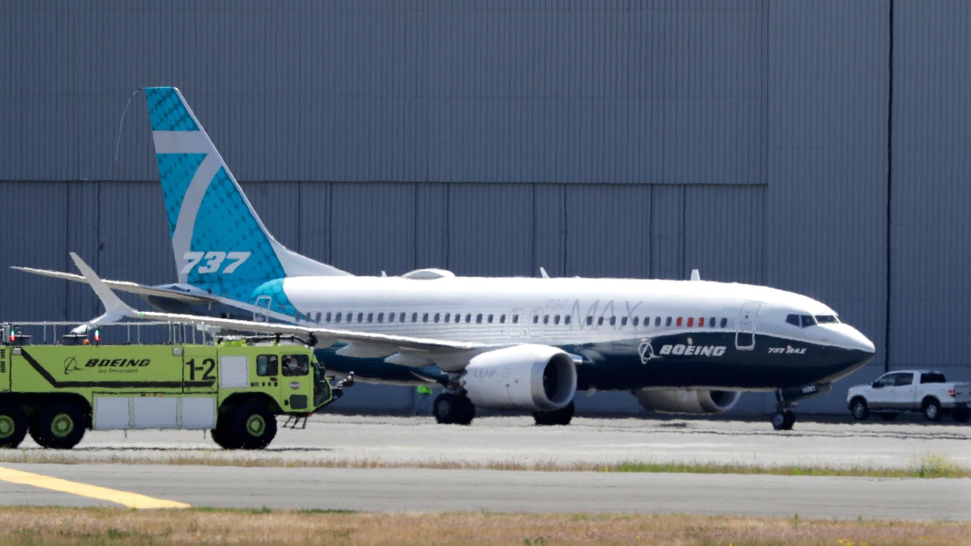 In this Monday, June 29, 2020, file photo, A Boeing 737 MAX jet taxis after landing at Boeing Field following a test flight in Seattle. (AP Photo / Elaine Thompson)