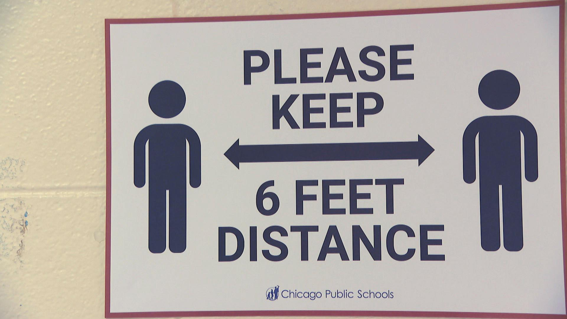 A sign promoting social distancing is shown inside a Chicago Public Schools building. (WTTW News)