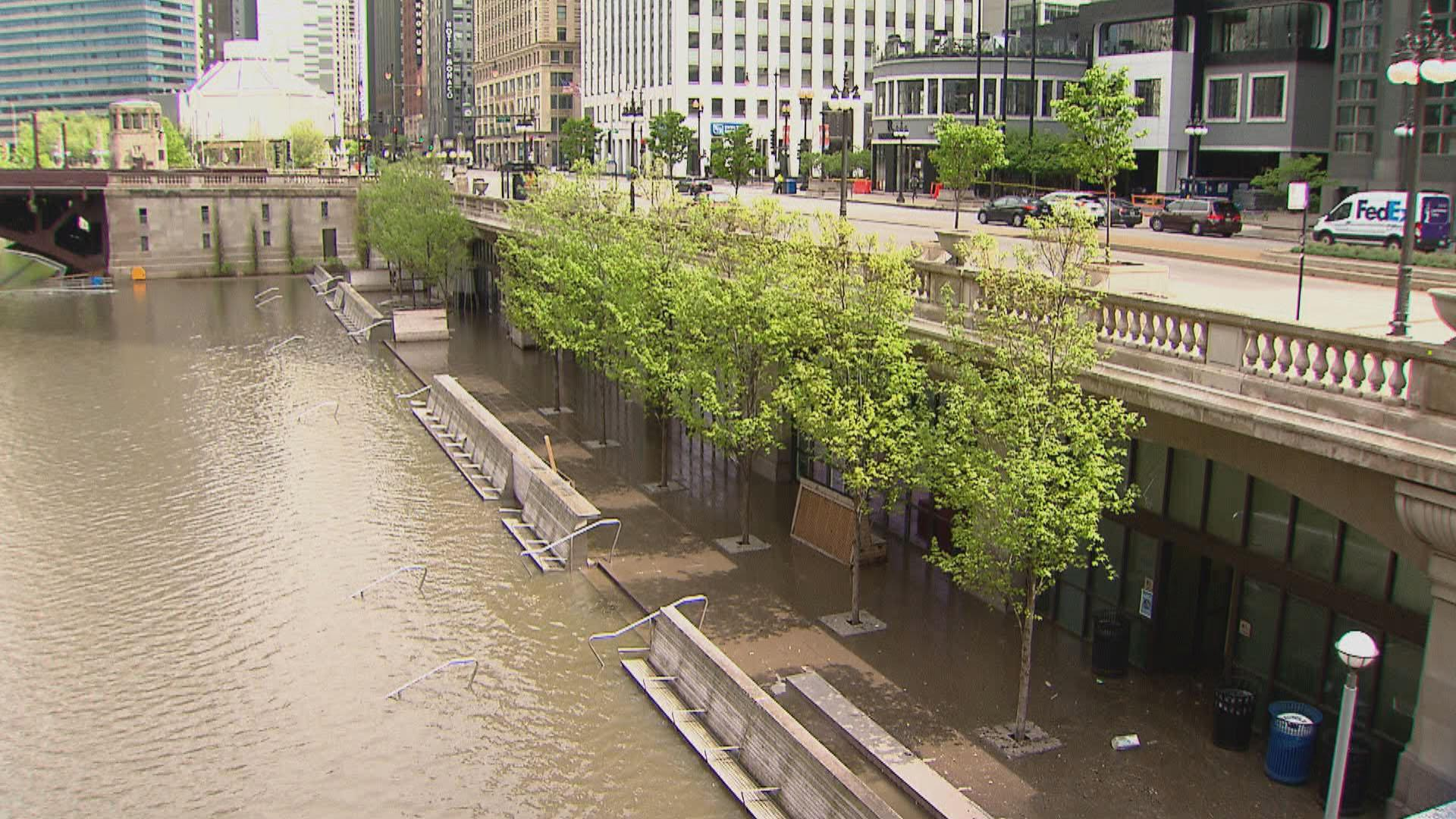 A flooded Riverwalk along the Chicago River. (WTTW News)