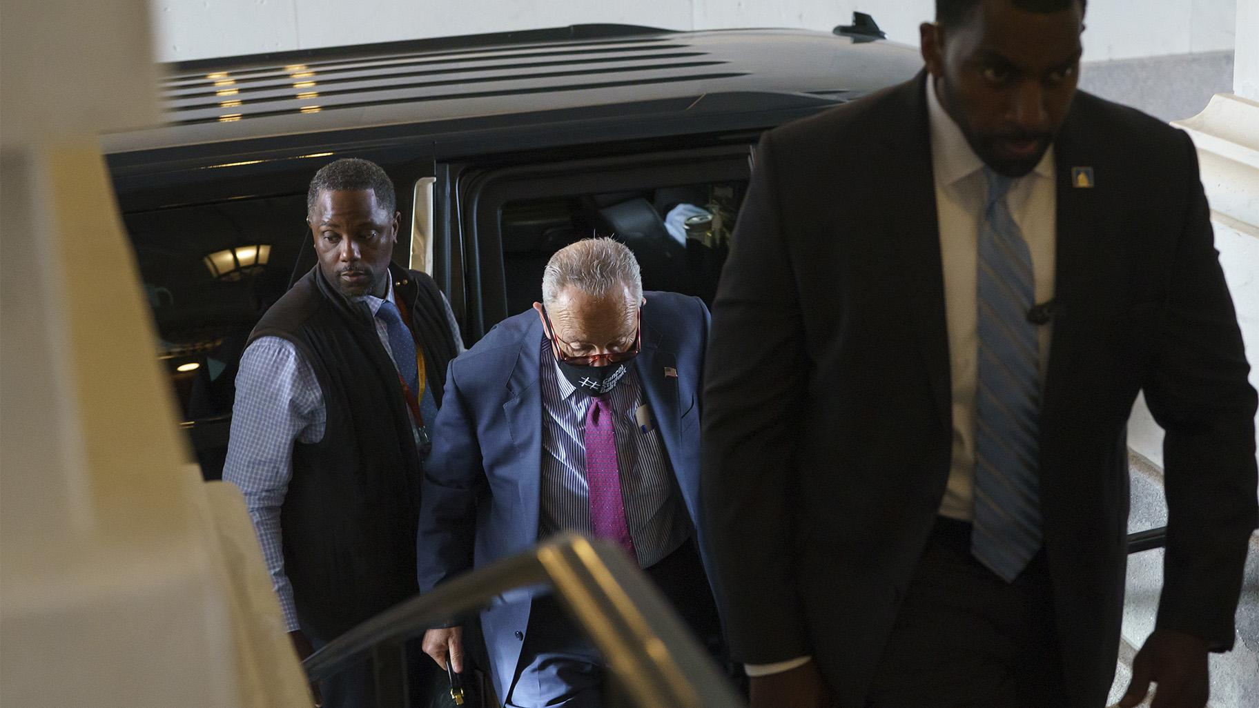 Senate Majority Leader Chuck Schumer, D-N.Y., arrives as the Senate convenes for a rare weekend session on the  trillion bipartisan infrastructure bill, at the Capitol in Washington, Saturday, Aug. 7, 2021. (AP Photo / J. Scott Applewhite)