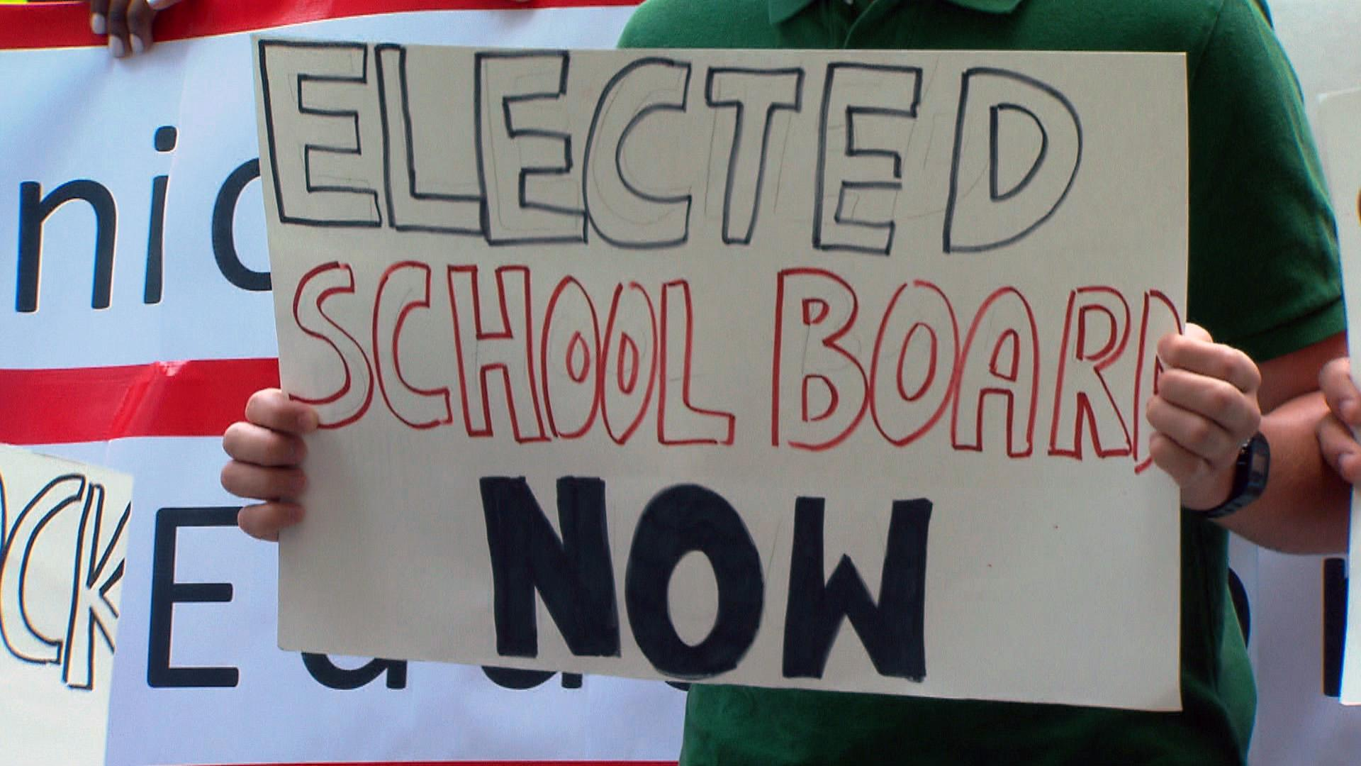 Supporters of an elected school board demonstrate in April 2019. (WTTW News)