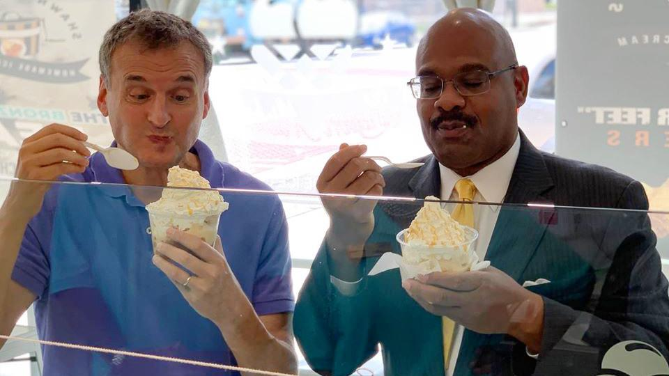 "Phil Rosenthal, left, digs into peach cobbler and ice cream during the Chicago episode of ""Somebody Feed Phil."" (Courtesy of Shawn Michelle's Ice Cream)"