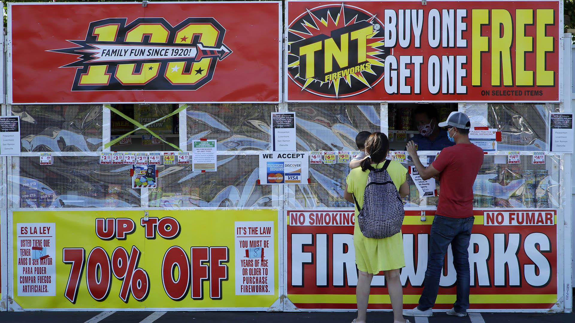 People purchase fireworks on Thursday, July 2, 2020, in Dublin, Calif. (AP Photo / Ben Margot)