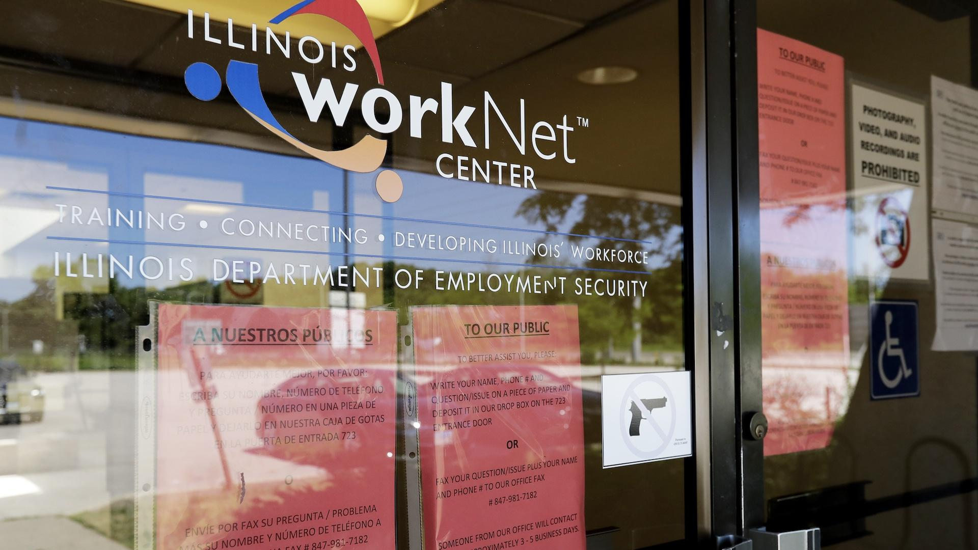 In this June 11, 2020, file photo, information signs are displayed at the closed Illinois Department of Employment Security WorkNet center in Arlington Heights, Ill. U.S. employers advertised for slightly fewer jobs in August while their hiring ticked up modestly. (AP Photo/Nam Y. Huh, File)