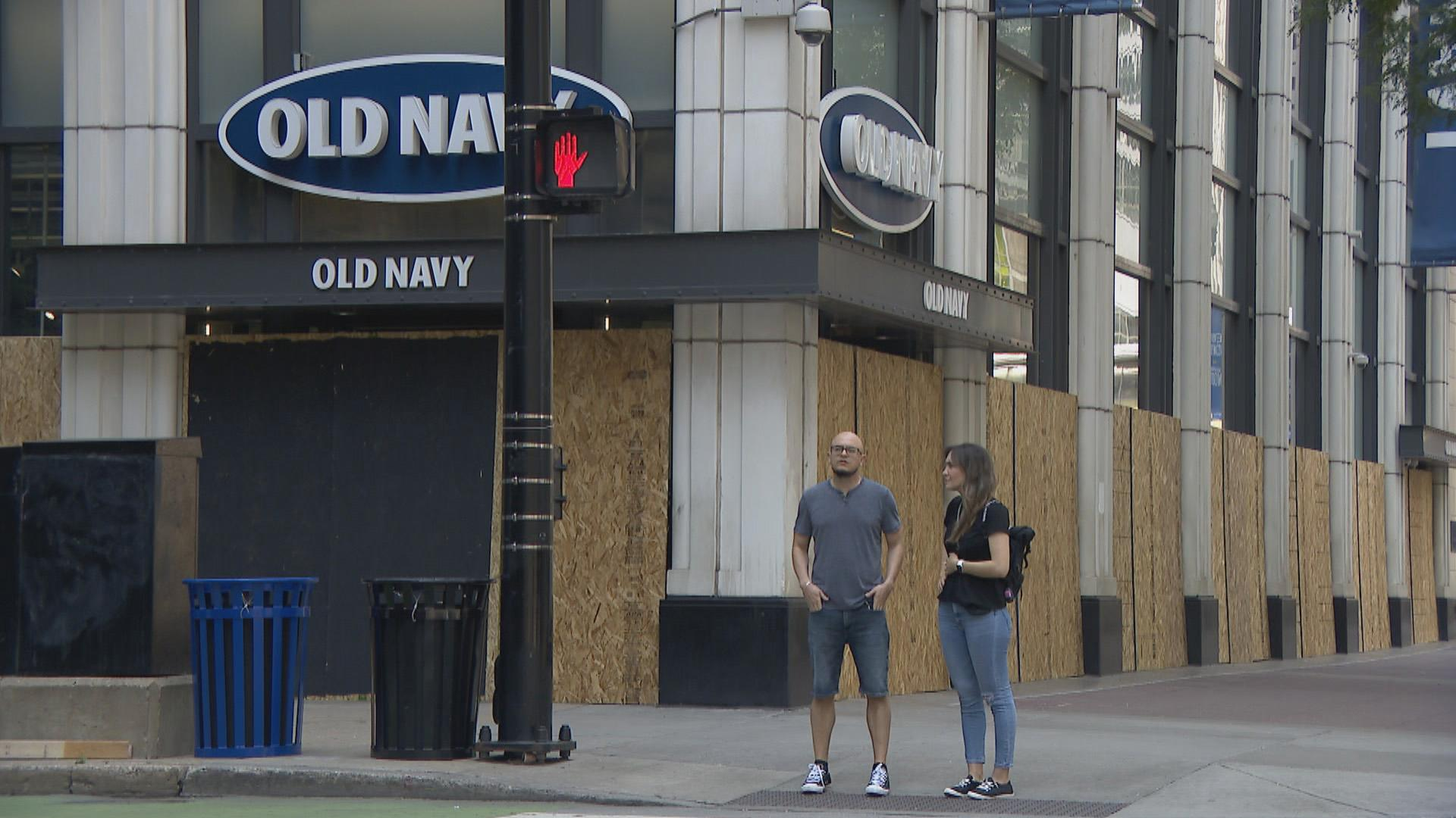 An Old Navy store in downtown Chicago is boarded up Monday, Aug. 10, 2020 after a night of looting and unrest. (WTTW News)