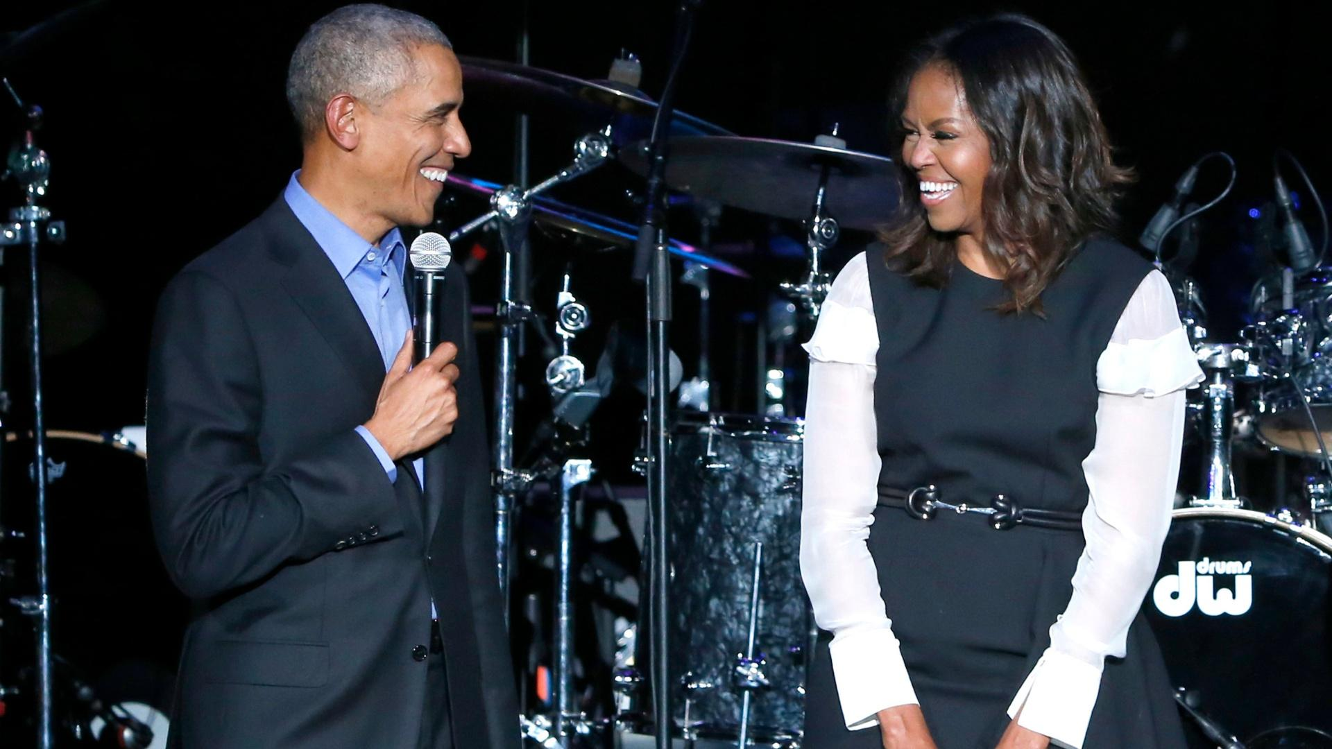 Former President Barack Obama, left, and former first lady Michelle Obama appear on stage during a community concert at the Obama Foundation Summit on Nov. 1, 2017, in Chicago. (AP Photo / Charles Rex Arbogast, file)