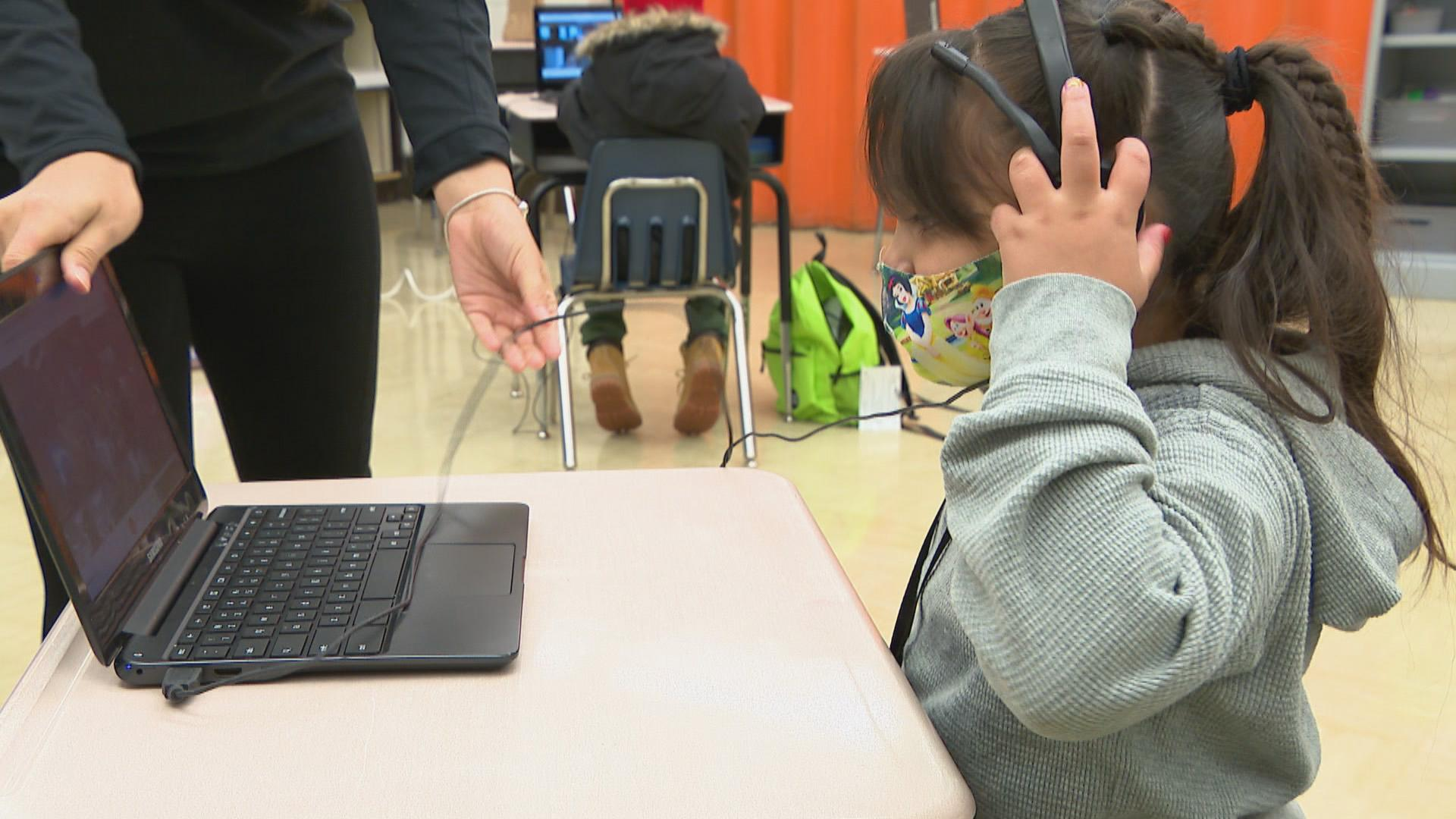 An elementary school student prepares to log onto her laptop for remote learning at A.J. Katenzmaier Academy in North Chicago on Oct. 30, 2020. (WTTW News)