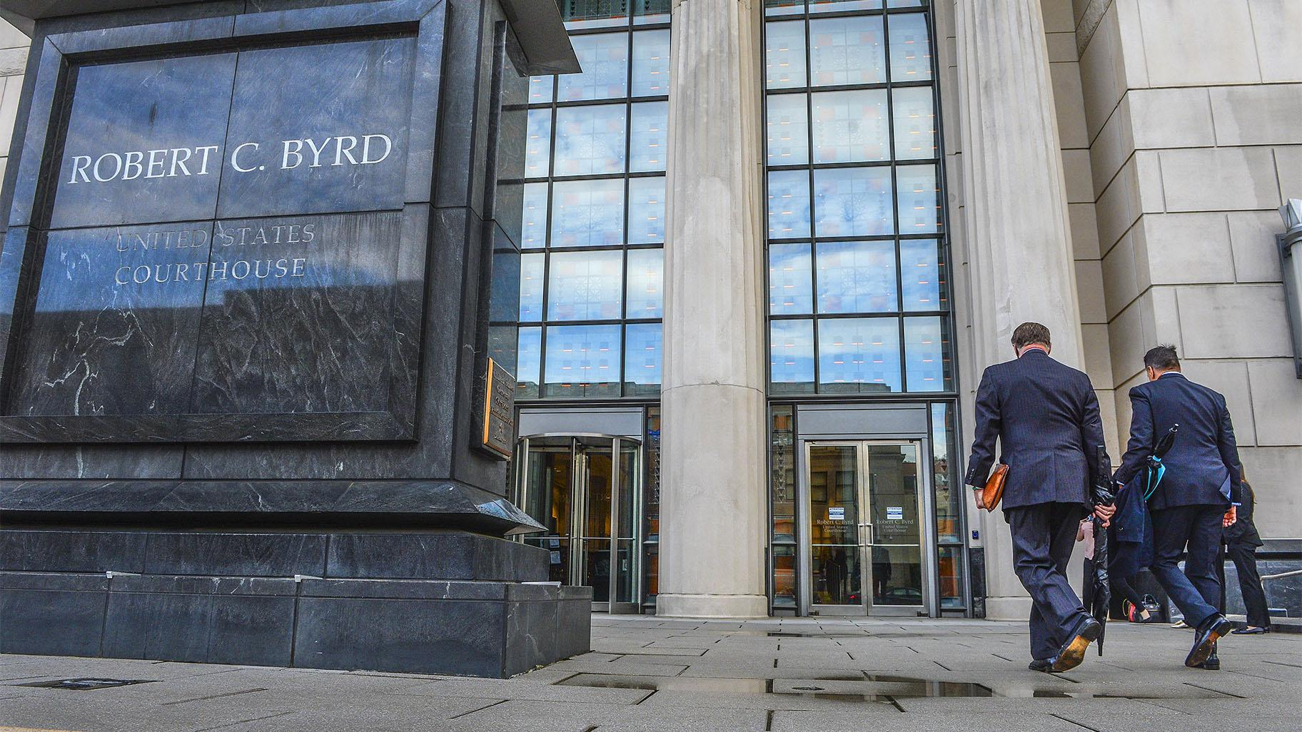 FILE - In this May 3, 2021, file photo, Huntington Mayor Steve Williams, left, and lawyer Rusty Webb enter the Robert C. Byrd United States Courthouse in Charleston, W. Va., for the start of the opioid trial. (Kenny Kemp / Charleston Gazette-Mail via AP, File)