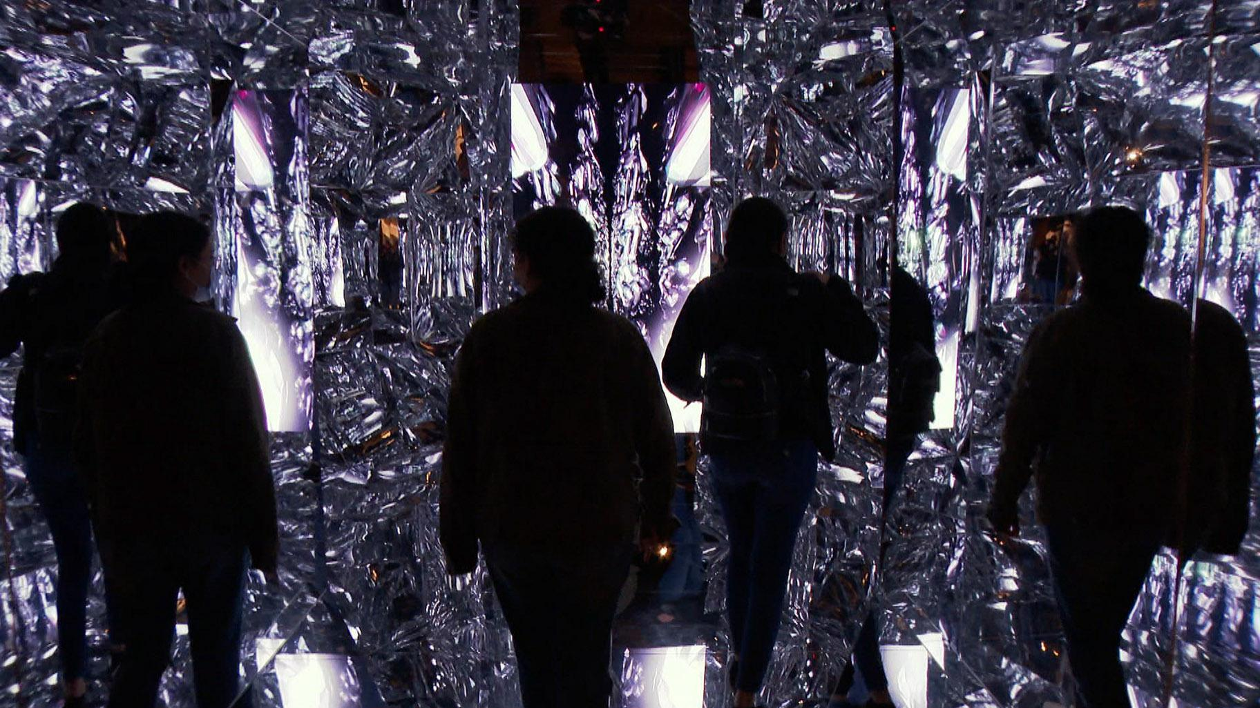 "Because this room of mirrors allows this NFT to fully encompass a physical space, that makes ""Quantum Mirror"" the very first NFT sculpture. (WTTW News)"