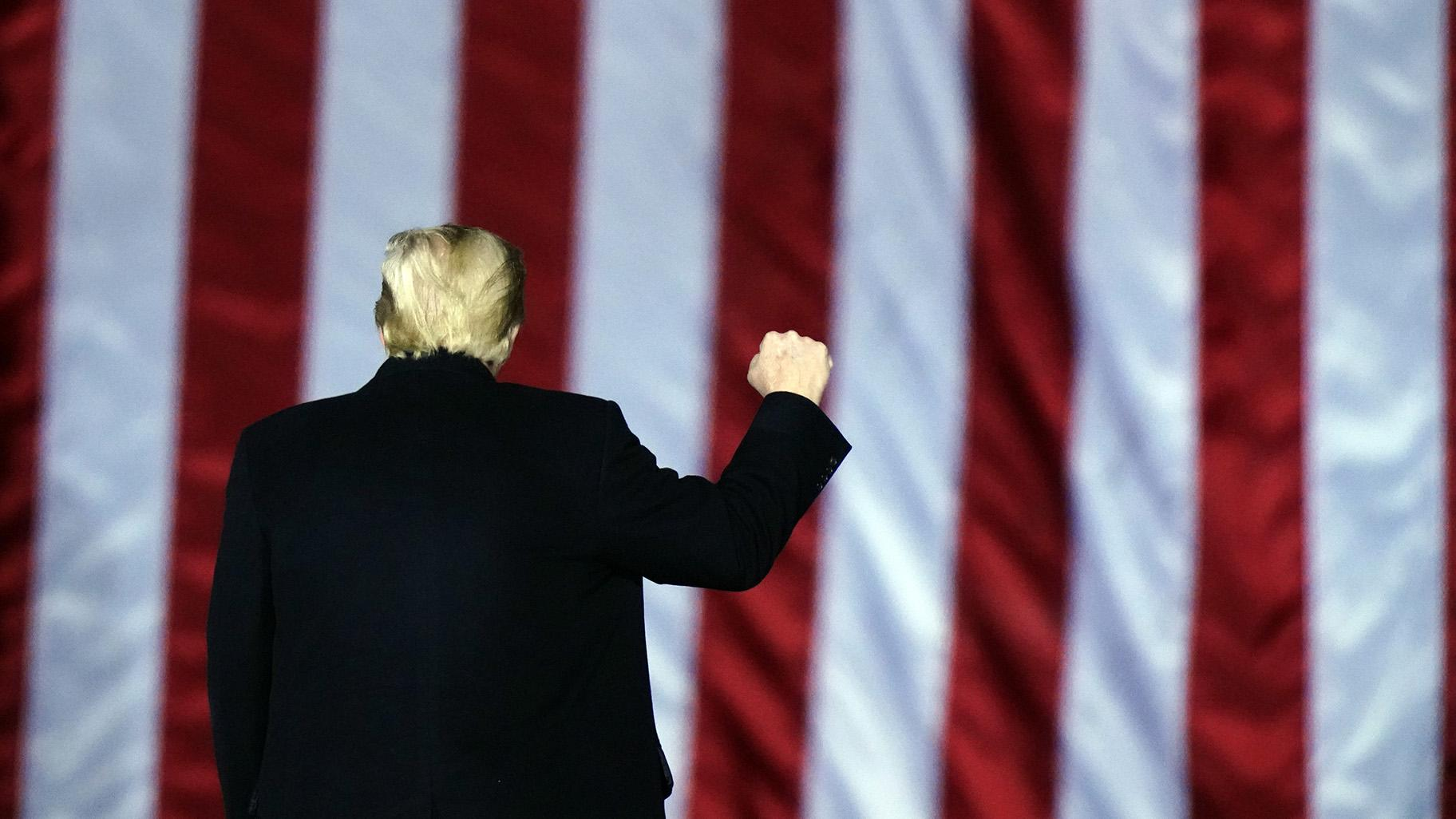 President Donald Trump gestures at a campaign rally in support of U.S. Senate candidates Sen. Kelly Loeffler, R-Ga., and David Perdue in Dalton, Ga., Monday, Jan. 4, 2021. (AP Photo / Brynn Anderson)